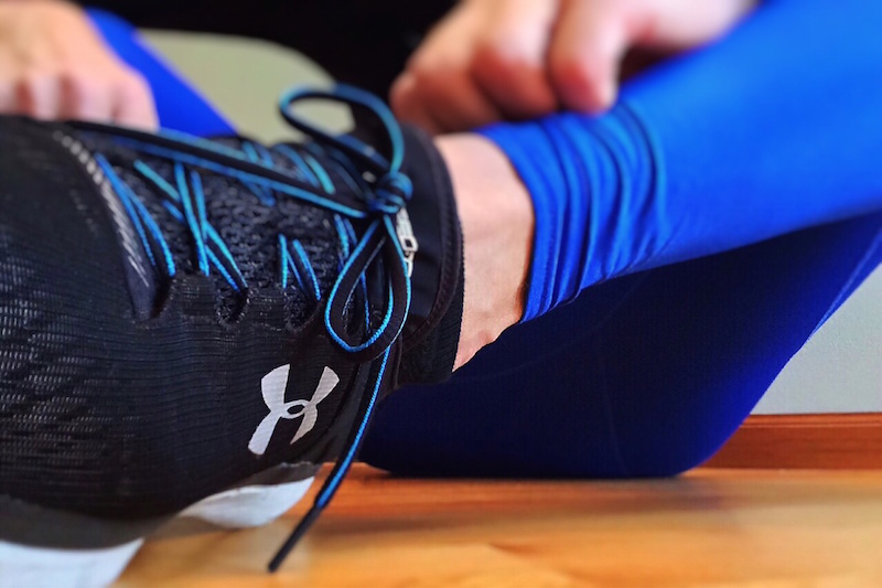 sportsperson lacing a trainer gym insurance