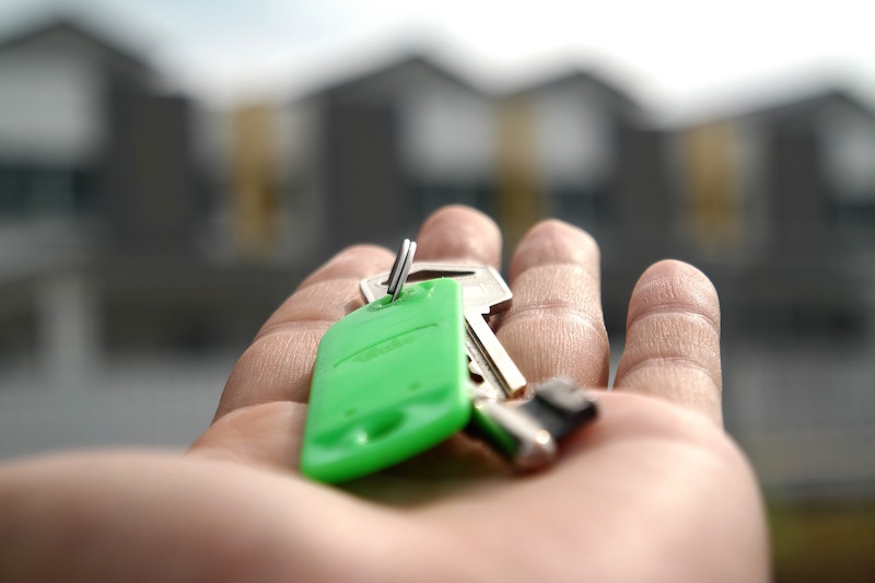 hand holding keys landlord registration