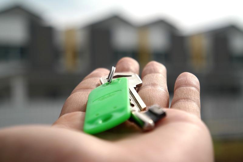 hand holding keys landlord registration