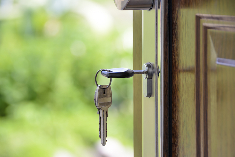 Keys and lock the door on the background of solar garden landlord tax