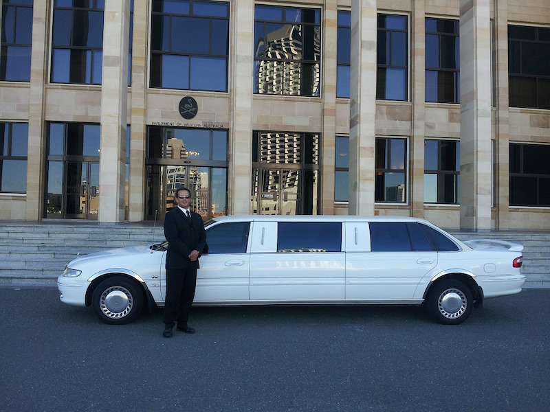 chauffeur driver in front of a limousine chauffeur insurance