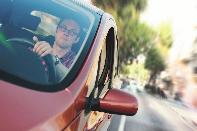 man driving red car temporary car insurance